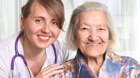 A Nurse with a Happy Elderly Woman